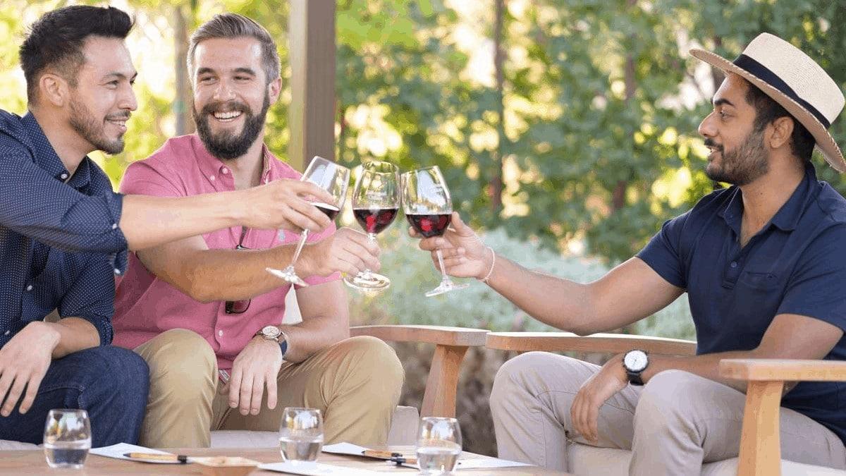 Three guys toasting at Cakebread Cellars