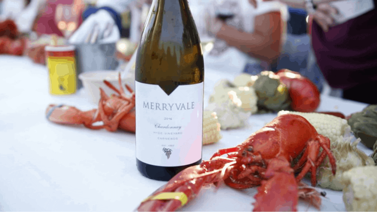 Lobster feed on table with Merryvale wine bottle