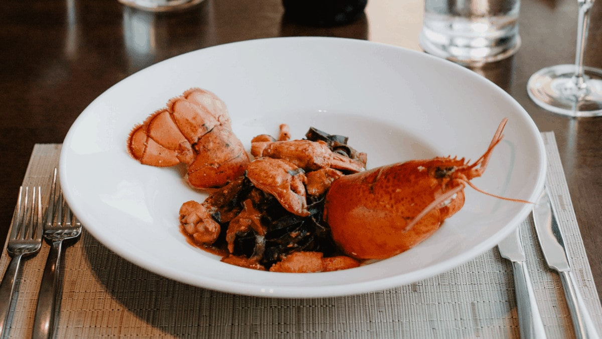 Cooked lobster plated on white bowl
