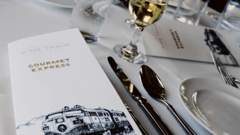 Napa Valley wine train program and wine glass